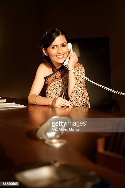 woman in sari on phone