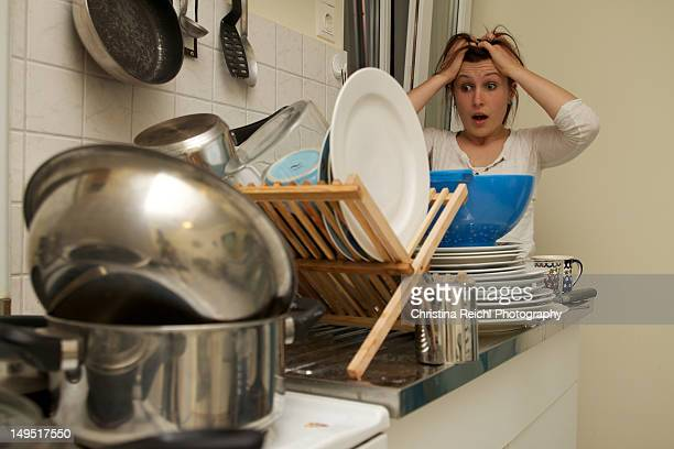 Woman in shock over doing dishes