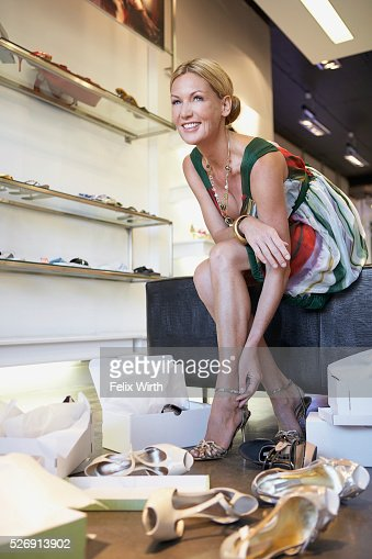 Woman in shoe store : Stock Photo