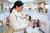 Young beautiful woman shopping in mall