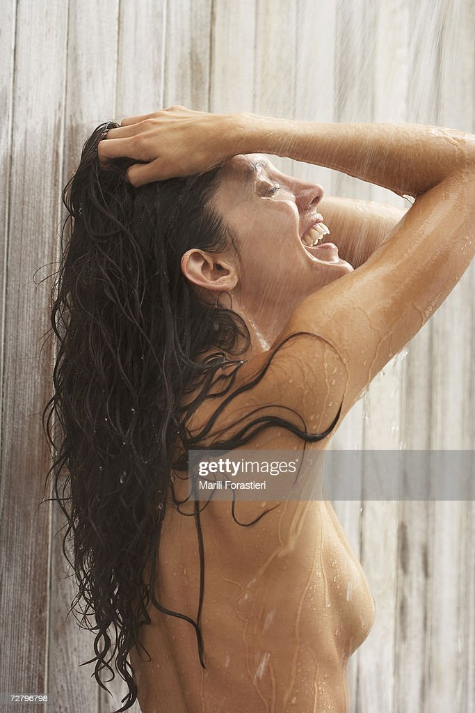 Woman in shower, hands in hair : Stock Photo