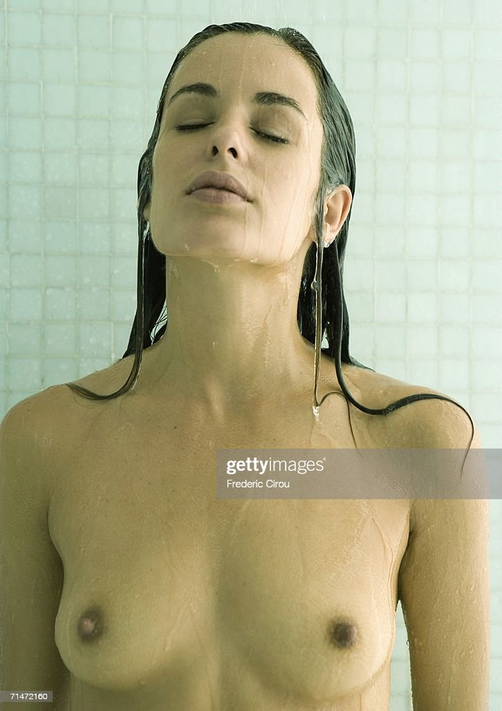Woman in shower with eyes closed : Stock Photo