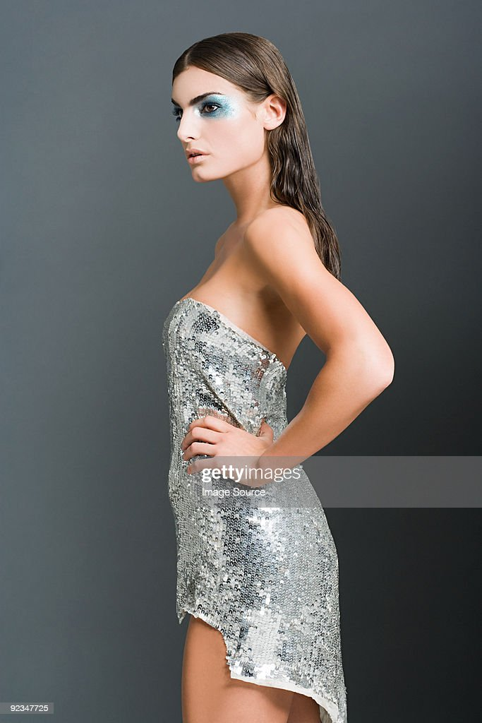 Woman in silver sequin dress
