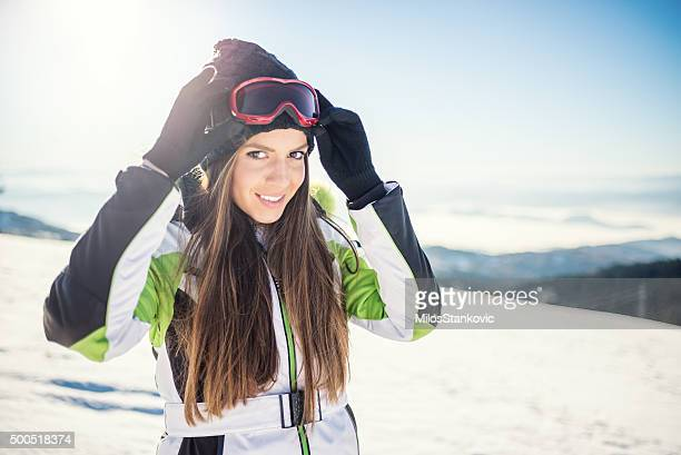 Woman in ski wear on the top of mountain