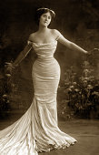 Woman in slim evening gown