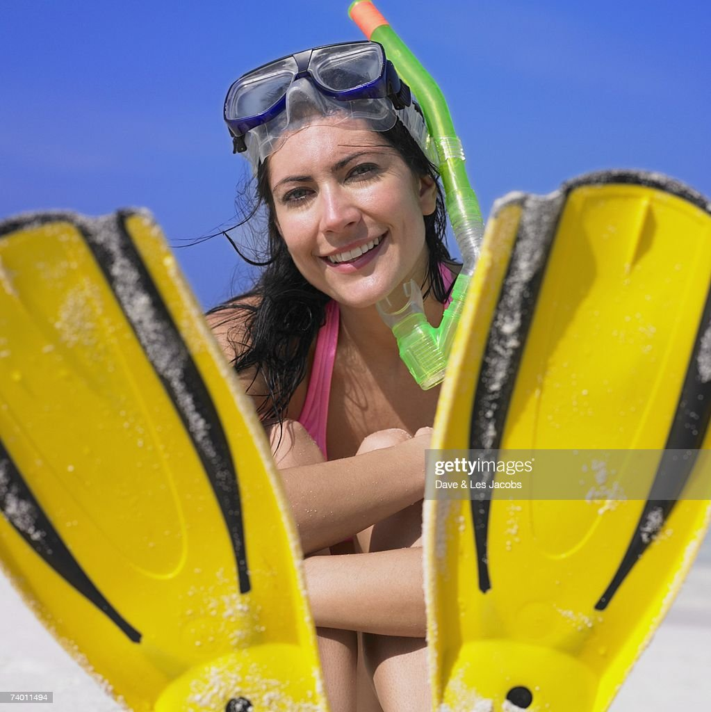 Woman in snorkeling gear at beach : Stock Photo