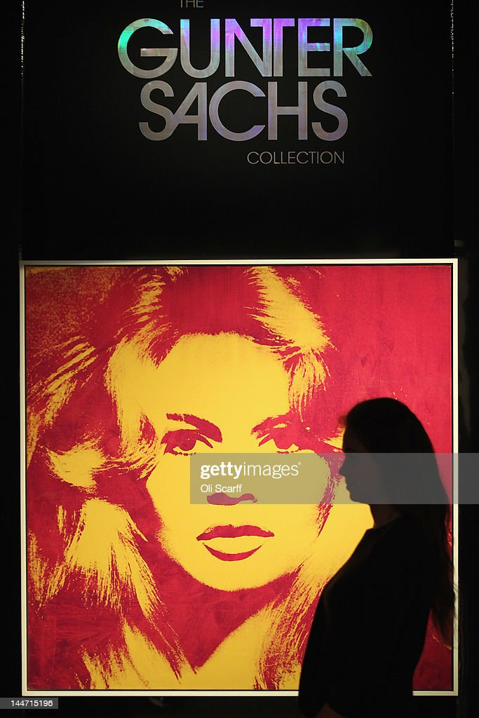 A woman in Sotheby's auction house views an artwork by Andy Warhol entitled 'Brigitte Bardot' with is expected to fetch 4 million GBP on May 18, 2012 in London, England. The artwork features in Sotheby's forthcoming sale from the collection of Gunter Sachs which is to be held on May 22 and 23, 2012 in London. The collection of over 300 works owned by the late husband of Brigitte Bardot is expected to fetch in excess of 20 million GBP.