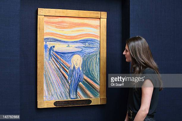 A woman in Sotheby's auction house views 'The Scream' by Edvard Munch on April 12 2012 in London England The iconic painting is on public exhibition...