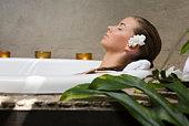 Woman in spa bath