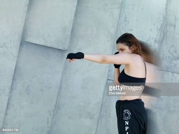 woman in sports outfit delivering a punch