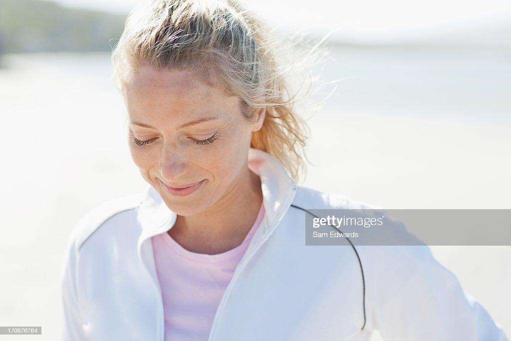 Woman in sportswear smiling : Stock Photo