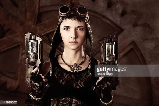 Woman in Steampunk Fashion With Guns