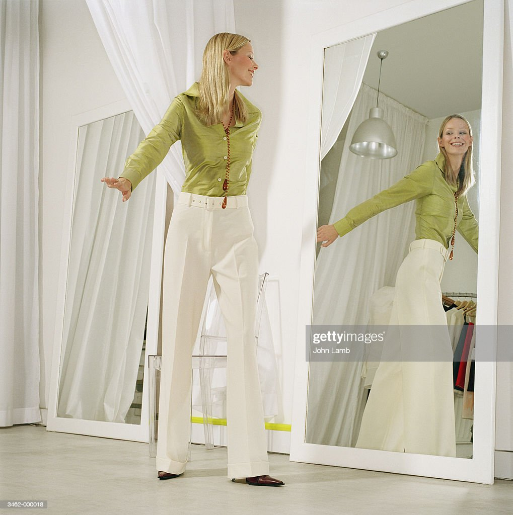 Woman in Store Fitting Room