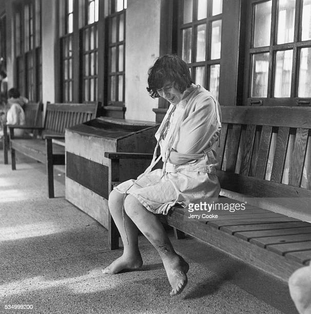 Woman in Straitjacket at a Psychiatric Hospital