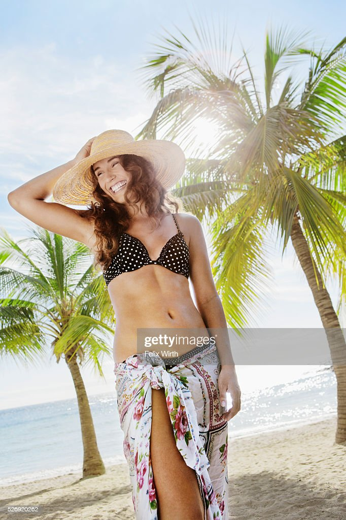 Woman in straw hat relaxing on beach : Foto stock