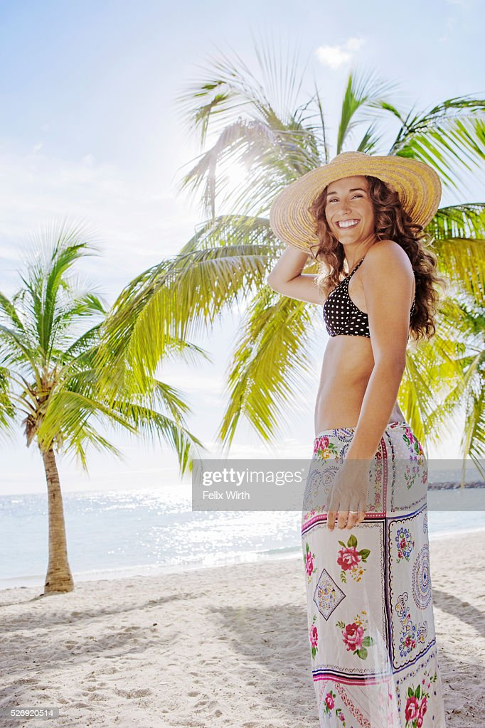 Woman in straw hat relaxing on beach : Stock Photo