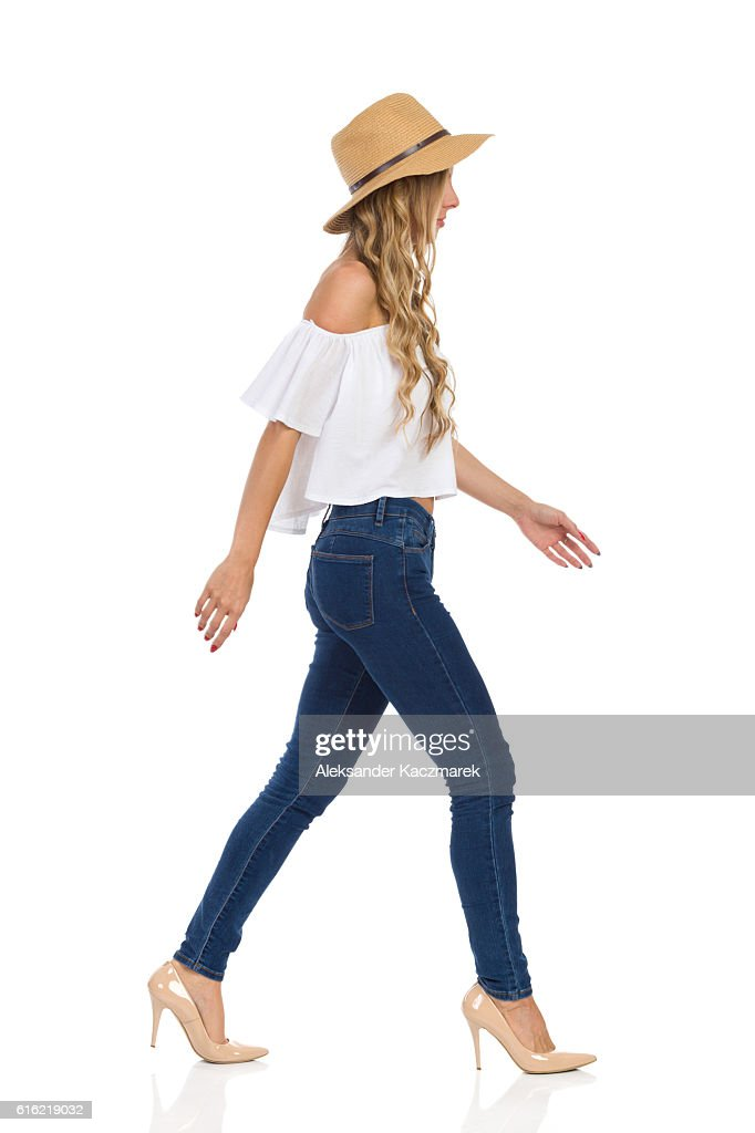 Woman In Straw Hat Walking Side View Isolated : Stock Photo