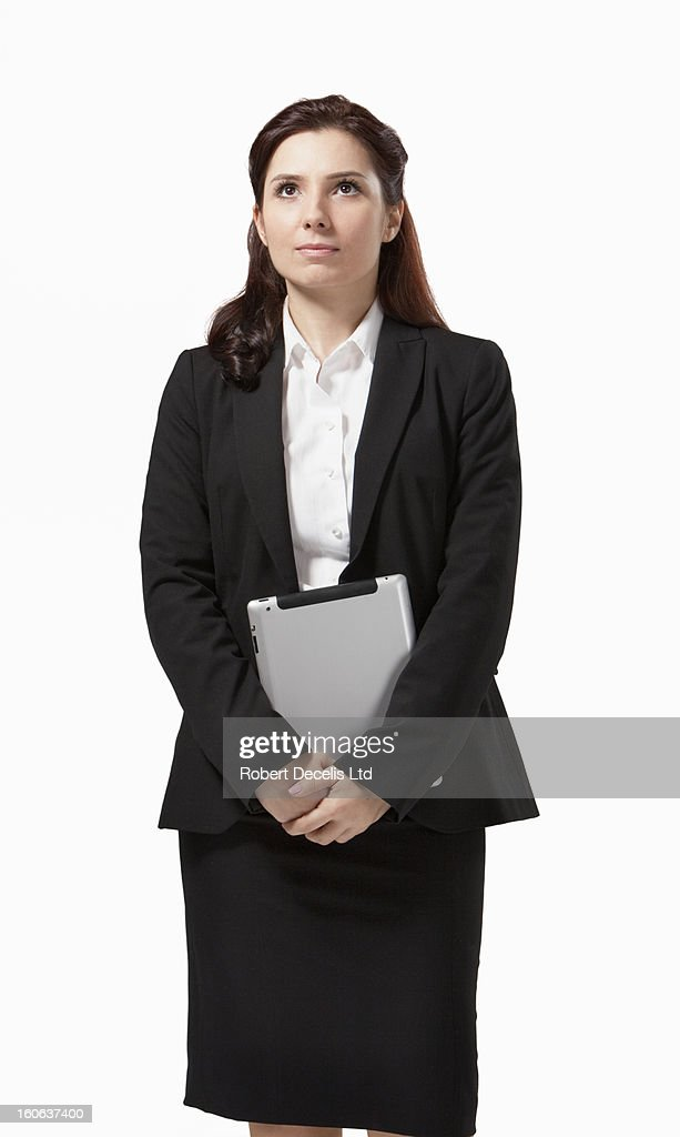 Woman in suit holding tablet : Stock Photo