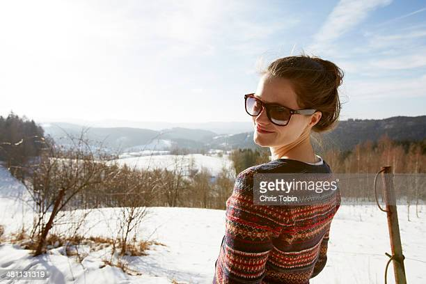 Woman in sunglasses in the snow