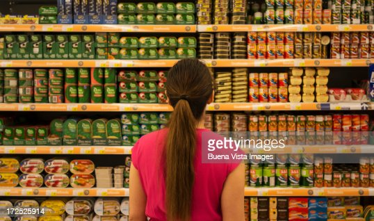 Woman in supermarket : Stock Photo