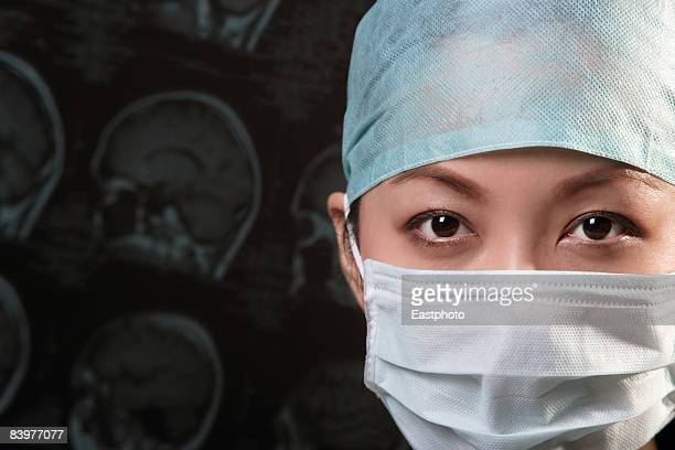 Woman in surgical wear.