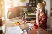 Woman in surroundings of digital technology