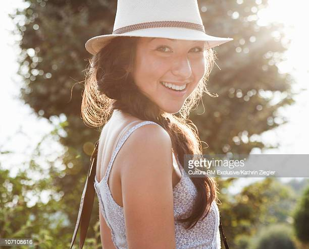 Woman in sweet afternoon light, smiling