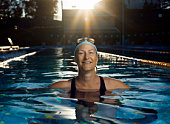 Woman in swimming pool at dusk