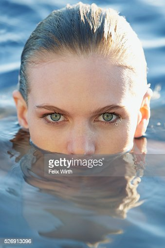 Woman in swimming pool : Stock Photo
