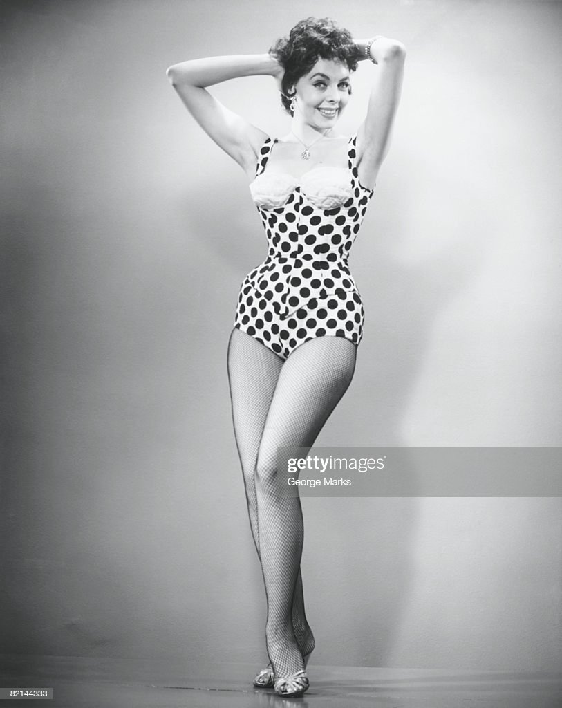 Woman in swimsuit posing in studio, (B&W), portrait : Stock Photo