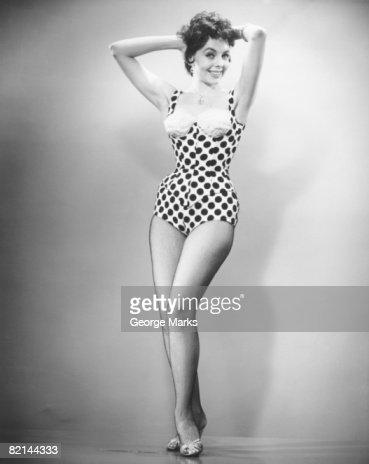 Woman in swimsuit posing in studio, (B&W), portrait : Stock Photo