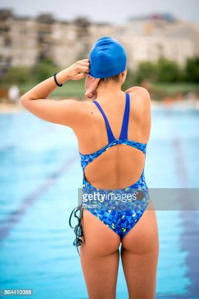 Woman in swimwear prepares for swimming training