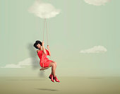 Woman in swing in empty simple landscape