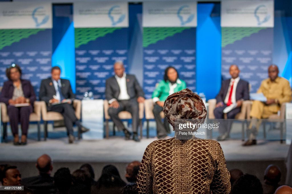 A woman in the audience asks a question durng the Civil Society Forum at the National Academy of Sciences as part of the first U.S.-Africa Leaders Summit on August 4, 2014 in Washington, DC. The event is set to promote business relationships between the United States and African countries during the first-ever leaders summit, where 49 heads of state will be meeting in Washington over the next three days.