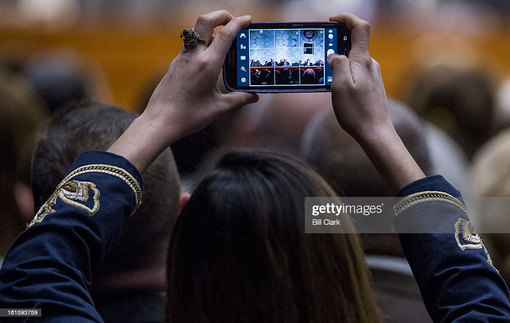 A woman in the audience takes a photo of the Senate Constitution, Civil Rights and Human Rights Subcommittee hearing on 'Proposals to Reduce Gun Violence: Protecting Our Communities While Respecting the Second Amendment.' in theHart Senate Office Building on Tuesday, Feb. 12, 2013.