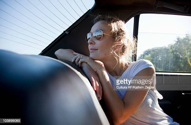 Woman in the back of a car, looking out