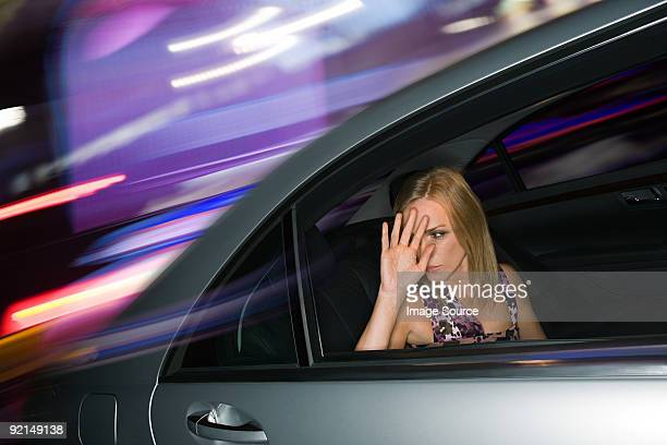 Woman in the back of a speeding car