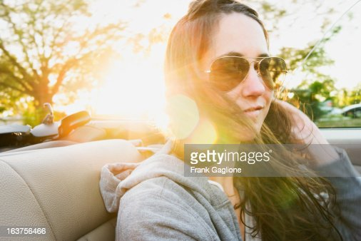 Woman in the Back seat of a Convertible. : Stock Photo