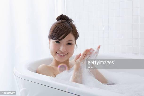 Woman in the bubble bath