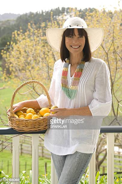 Woman in the country with a basket of fruit