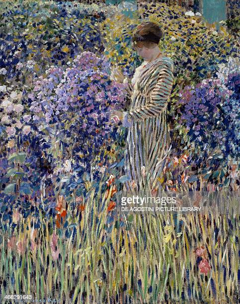 Woman in the garden ca 1912 painting by Frederick Carl Frieseke oil on canvas 81x65 cm