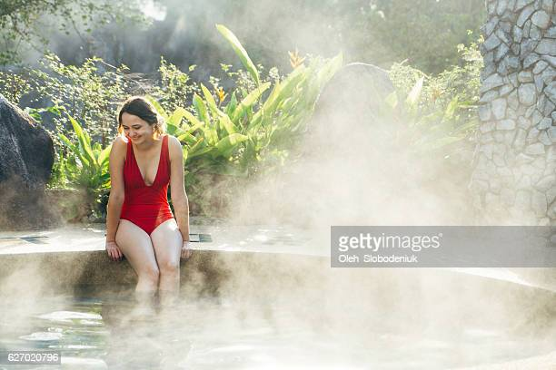 Woman in the hot spring pool