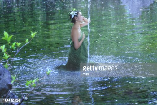 Woman in the lake : Stock Photo