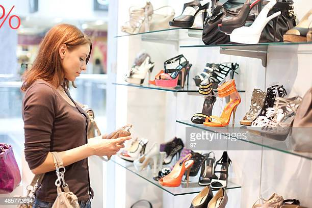 Woman in the shop to buy shoes