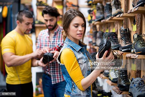 Woman in the store looking at hiking boot