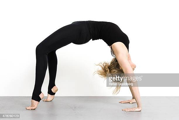 Woman in tights doing yoga exercise