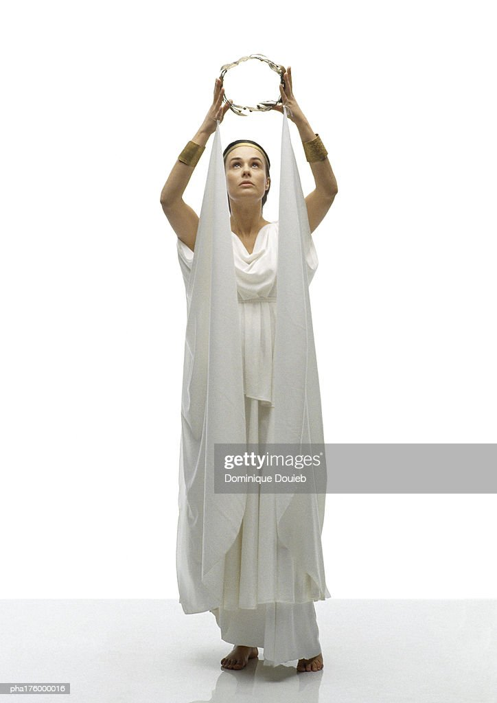 Woman in toga holding crown of laurels