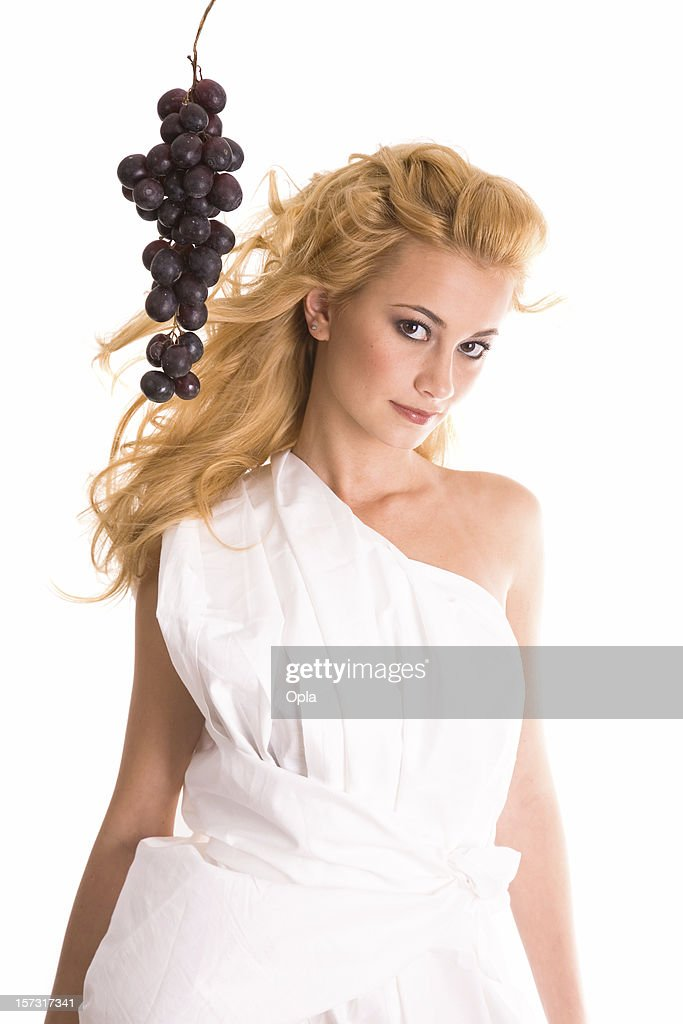 Woman in toga with grapes