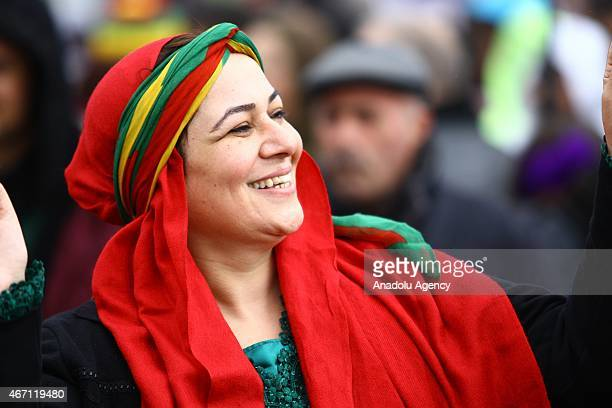 A woman in traditional clothes attend the Nowruz celebrations at Nowruz Park in Baglar district of Diyarbakir Turkey on March 21 2015 People wear...