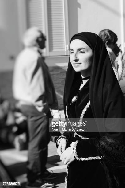 Woman In Traditional Clothing Looking Away On City Street